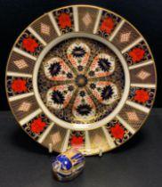 A Royal Crown Derby 1128 imari dinner plate, 26.5cm diameter, 1st; a Millennium Bug paperweight,