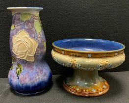 A Royal Doulton stoneware vase tubelined with flowers, impressed marks; similar fruit bowl