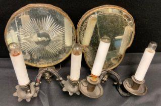 An early 20th century two branch girandole wall light, skull shaped mirror reflector back, 28.5cm