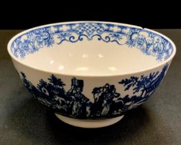 A Worcester Dr Wall period pedestal bowl, decorated with pastoral scenes on blue on a white