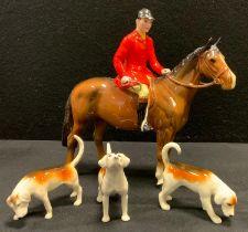 A Beswick model Huntsman, brown gloss, three assorted hounds (4)