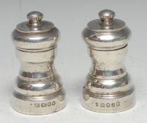 A pair of Elizabeth II silver pepper grinders, 8.5cm high, London 1980