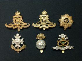 WW2 British cap badge collection comprising of : Royal Artillery cap badges x 2, Royal Army