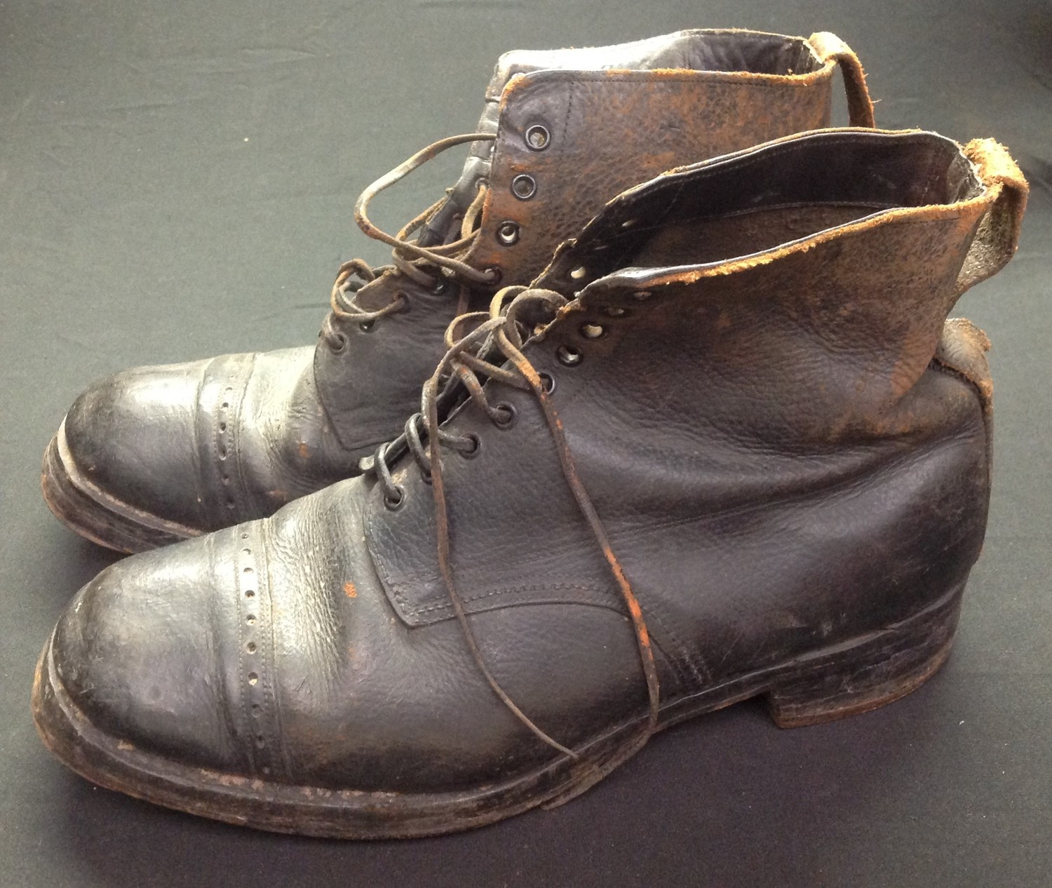 """A pair of black leather lace up ankle boots. Marked to the inside on both boots """"7 32 1917"""". Soles - Image 2 of 7"""