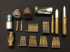 A collection of mixed assorted INERT FFE rounds, shell fuzes, etc. To include tail fin from a WW2
