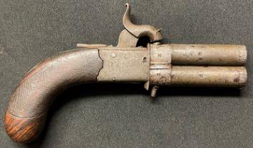 A small revolving double barrel Percussion cap pistol. Barrel length 67mm. Heavily rifled bore