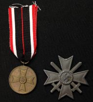 WW2 Third Reich Kriegsverdienstmedaille - War Merit Medal. No makers mark to ring. Complete with