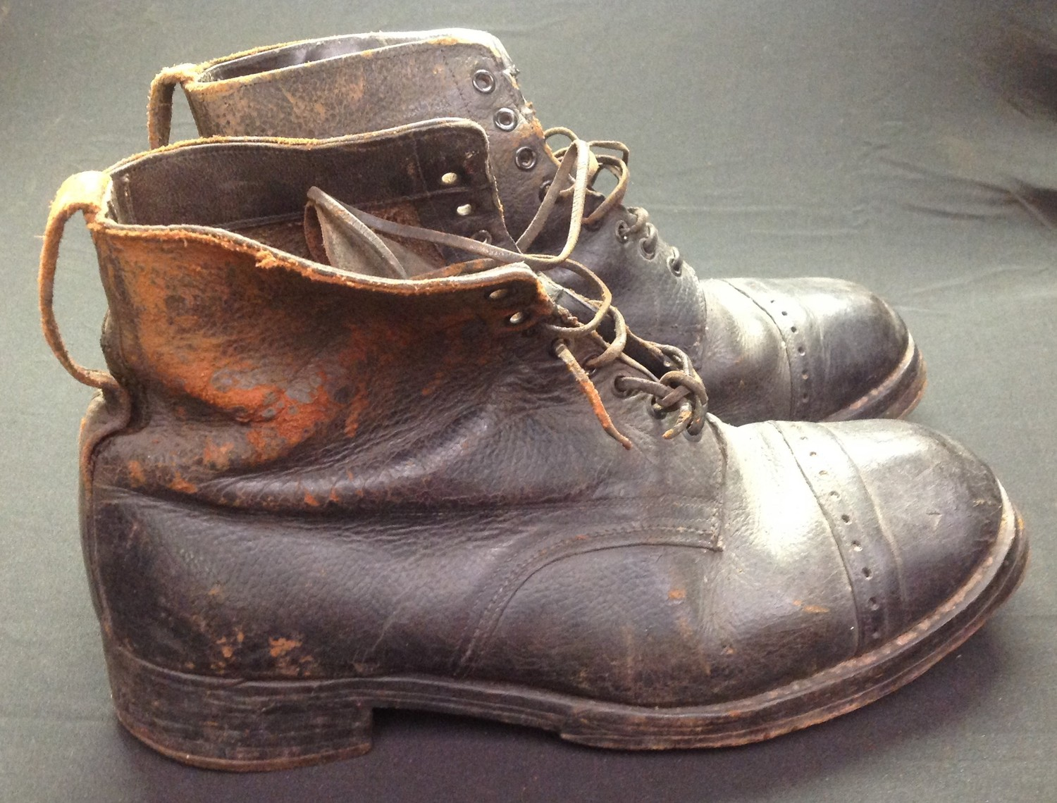 """A pair of black leather lace up ankle boots. Marked to the inside on both boots """"7 32 1917"""". Soles"""