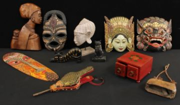 Tribal Art - an Indonesian mask, another dragon mask; an African carved figure; cat models, brass