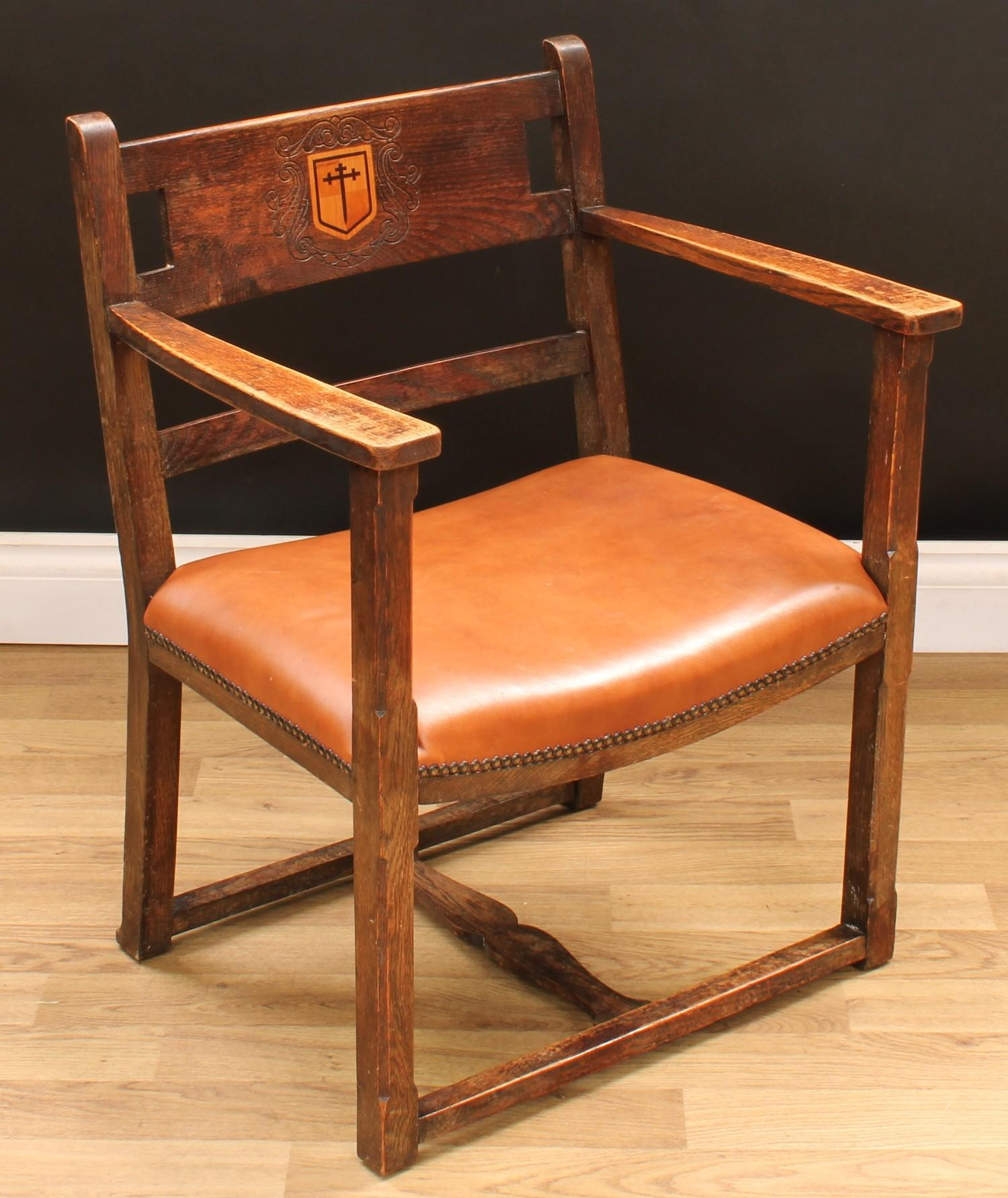 An Arts & Crafts ecclesiastical open armchair, curved cresting rail centred by a shield shaped - Image 2 of 4