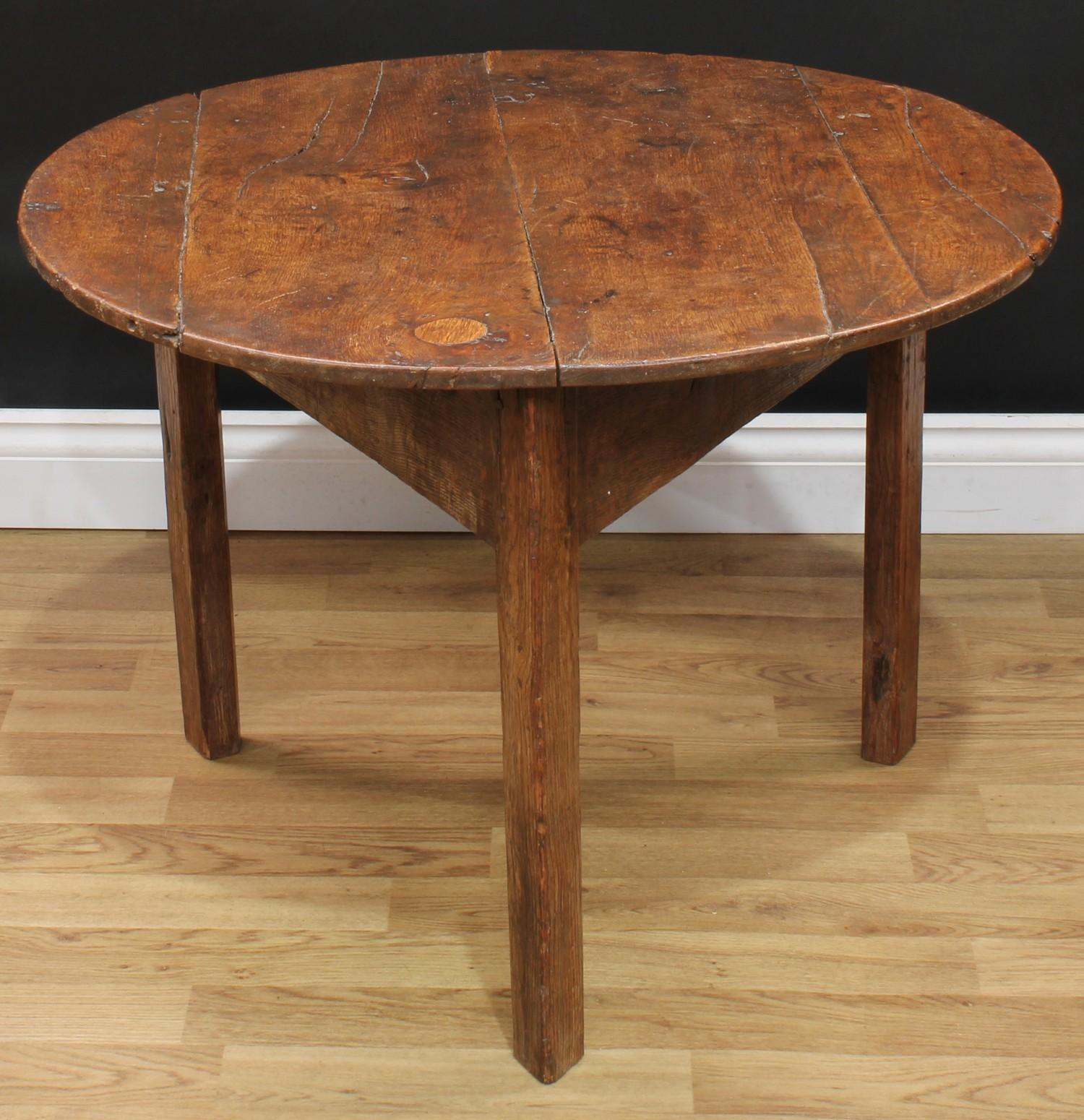 A 19th century oak cricket table, circular top, chamfered legs, 55.5cm high (reduced), 77cm diameter - Image 2 of 2