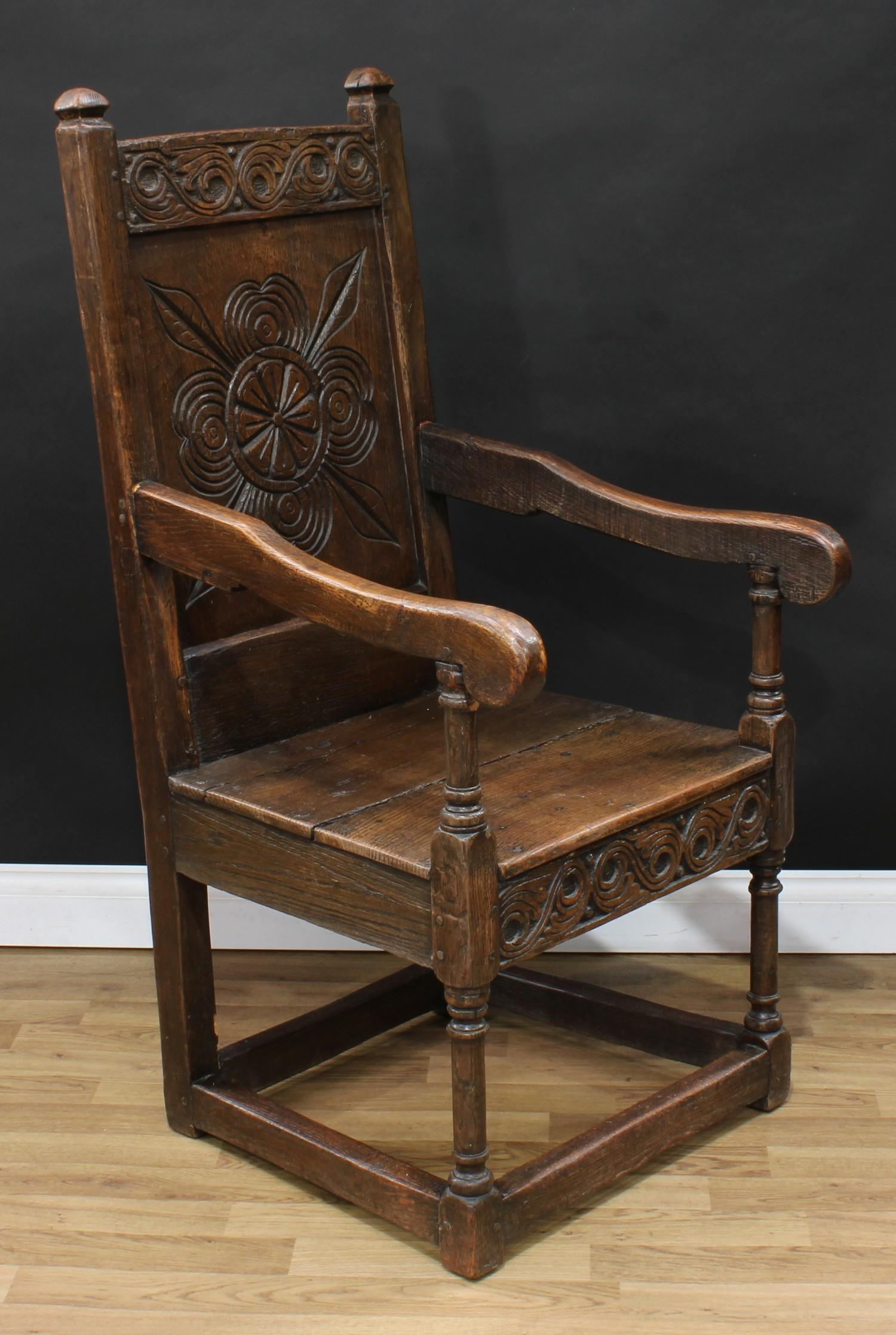 An 18th century oak Wainscot armchair, possibly Cheshire, rectangular cresting rail carved with - Image 3 of 4