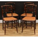 A set of four Regency brass mounted mahogany side chairs, each with a bobbin-flanked rope twist