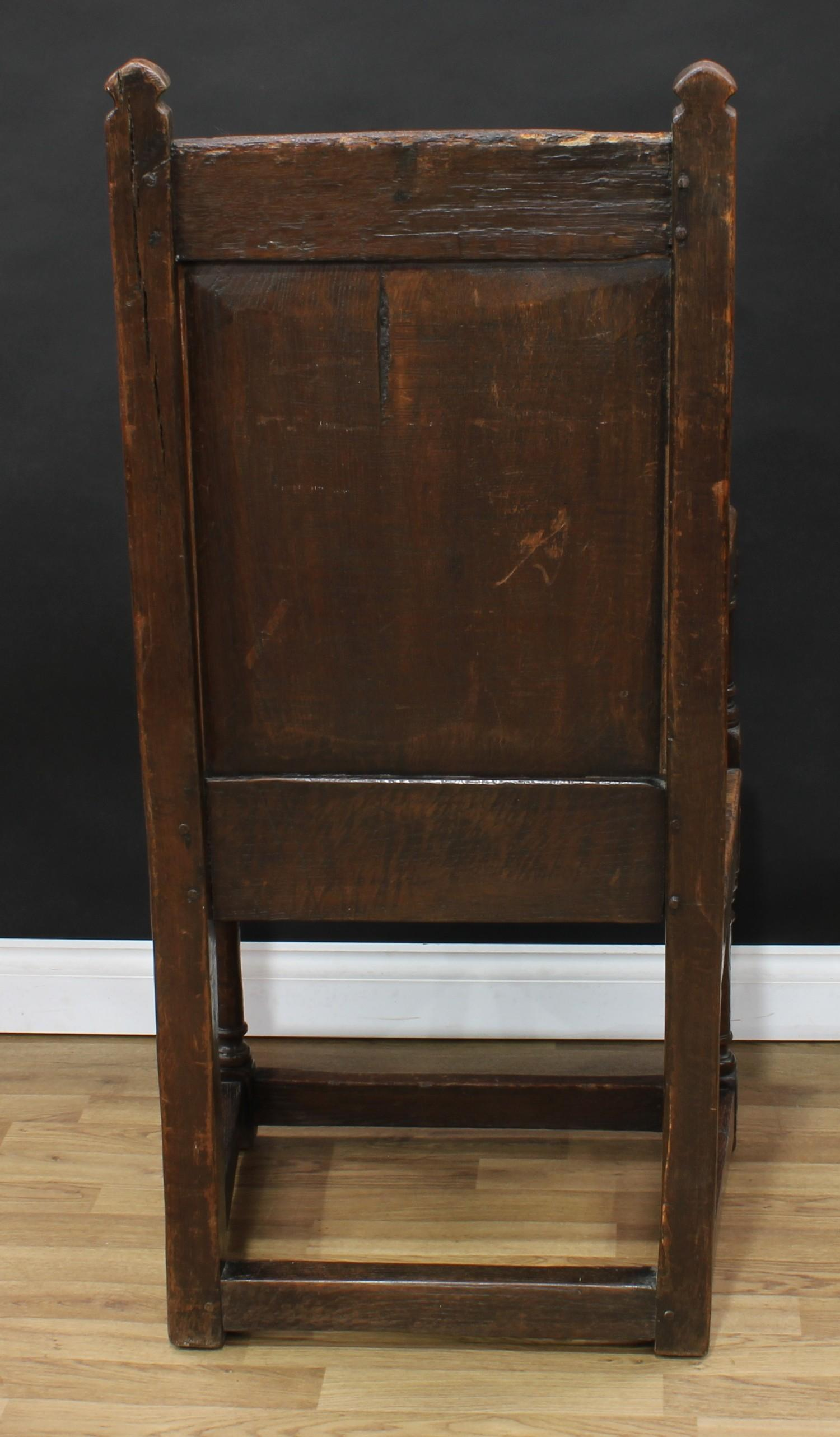An 18th century oak Wainscot armchair, possibly Cheshire, rectangular cresting rail carved with - Image 4 of 4