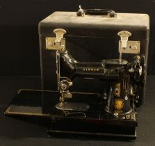 A Singer 222K portable electric sewing machine, black carry case