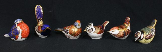 A Royal Crown Derby paperweight, Fairy Wren, gold stopper; others, Robin, no stopper; Linnet, gold