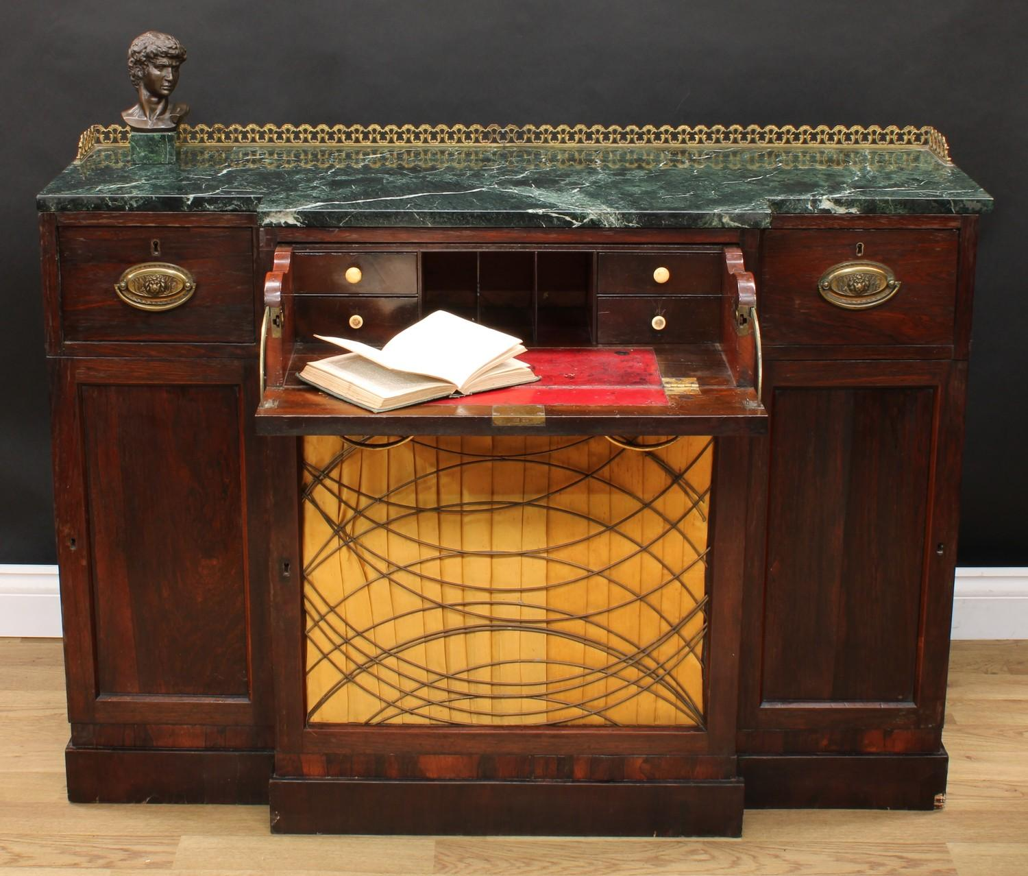 A 'Regency' rosewood break-centre secretaire side cabinet, verde antico marble top with three-