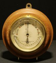 A late 19th/early 20th century circular aneroid barometer, the dial with crescent shaped
