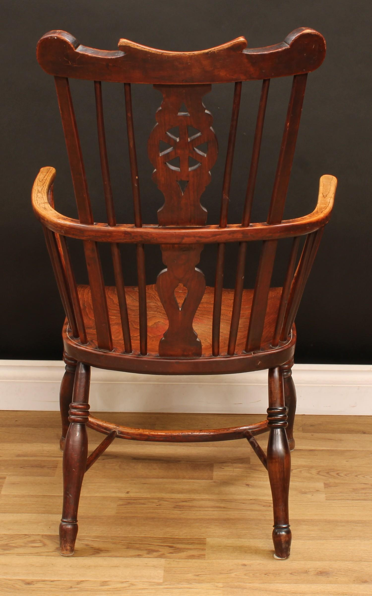 A country house ash and elm Windsor elbow chair, shaped cresting rail above a wheel back splat, - Image 4 of 4