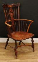 A country house ash and elm Windsor elbow chair, shaped cresting rail above a wheel back splat,