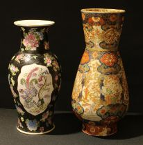 Oriental Ceramics - a Chinese famille noire porcelain baluster vase, painted with famille rose
