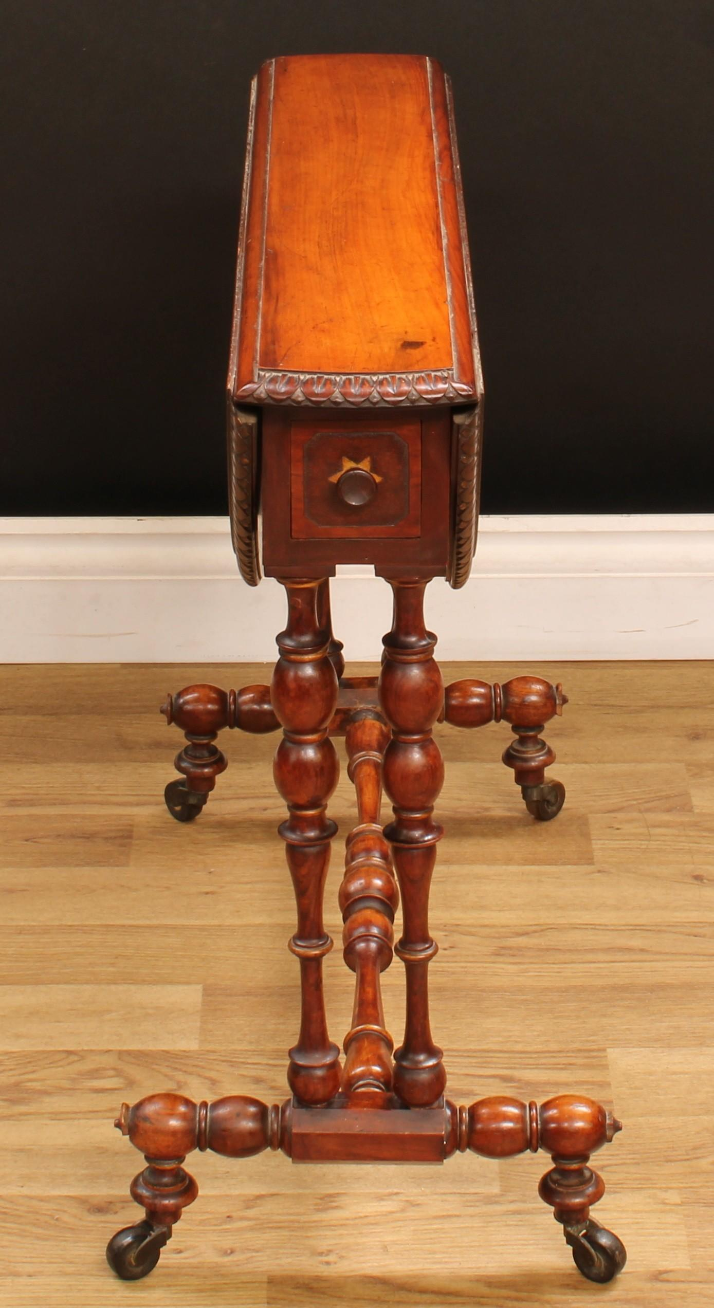 A Victorian walnut Sutherland table, oval top with fall leaves and lotus carved edge, above a pair - Image 5 of 5