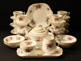 A Crown Staffordshire tea set, printed with colourful summer flowers, comprising, teapot, milk and