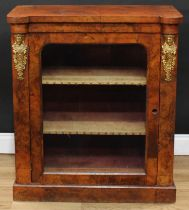 A Victorian gilt metal mounted walnut pier display cabinet or bookcase, hipped rectangular top above