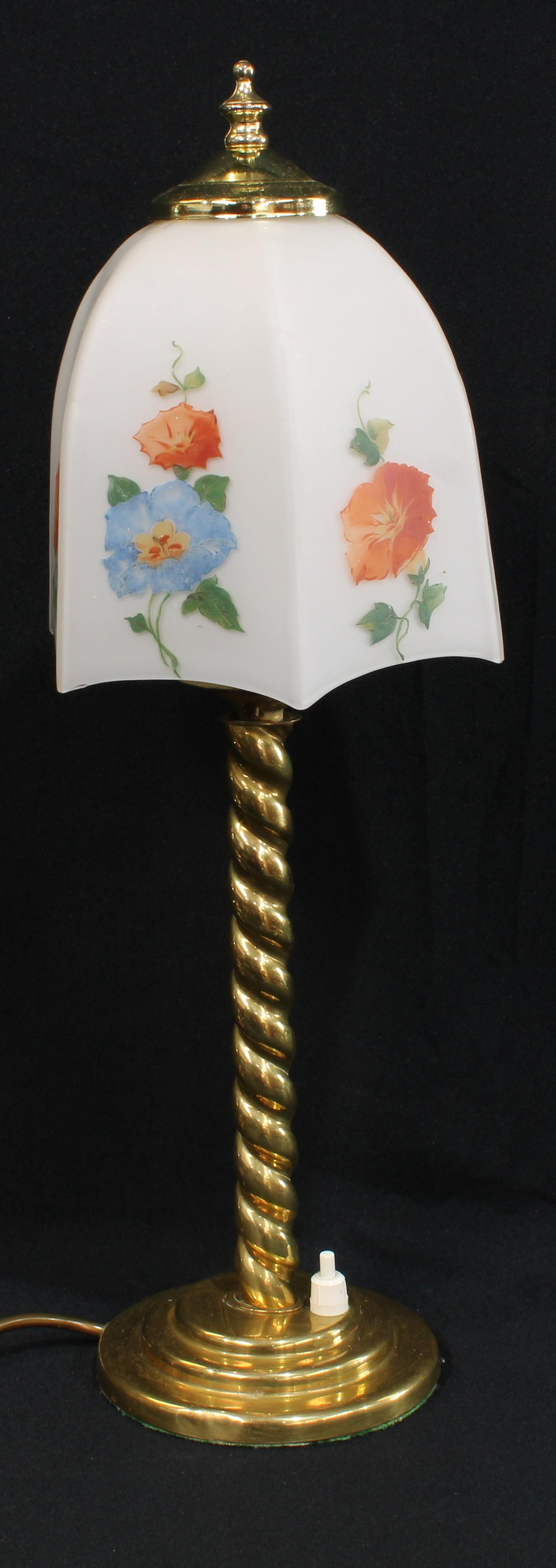 A brass barley twist table lamp, opaque glass shade decorated with flowers, 46.5cm high