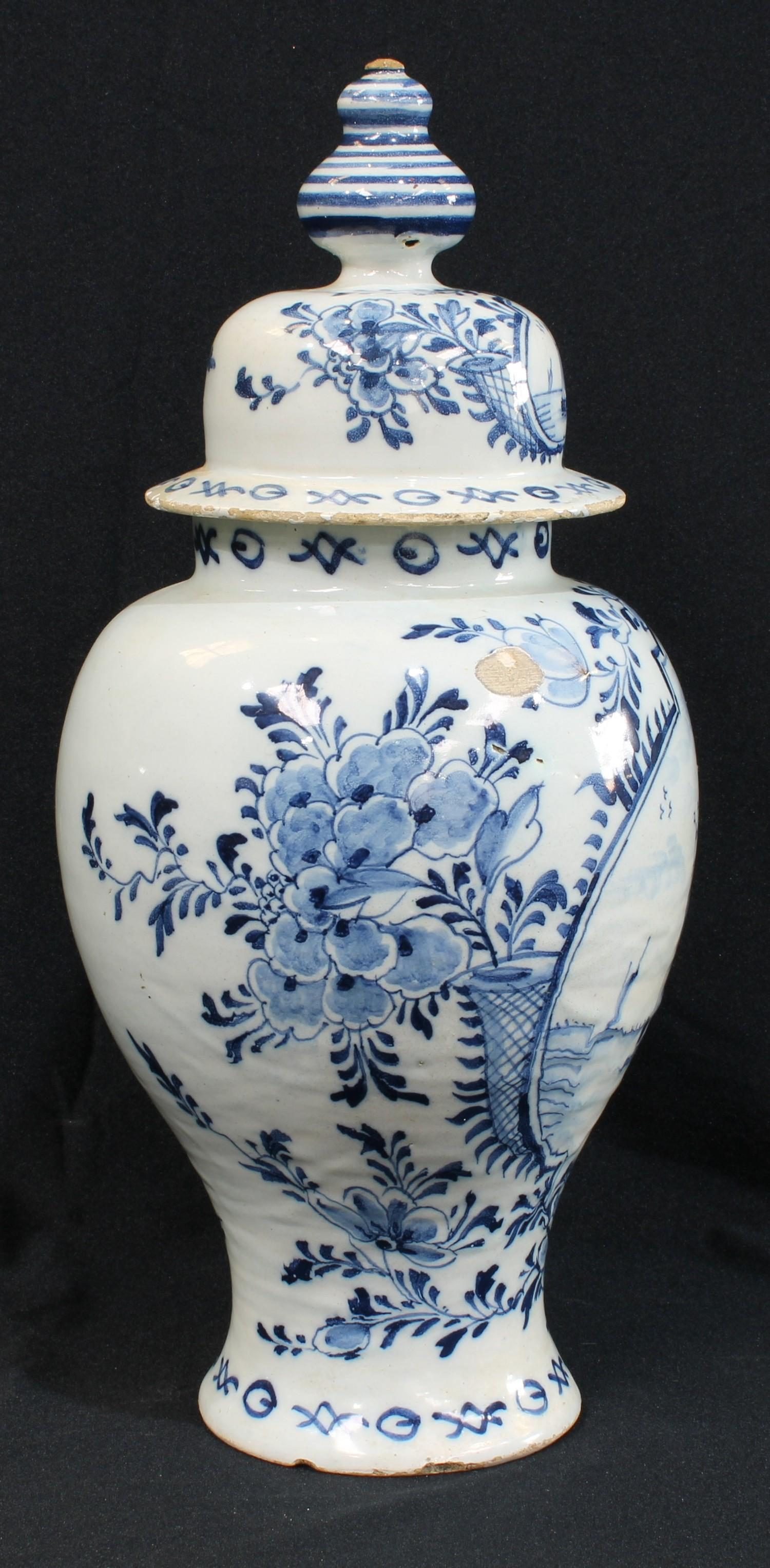 A late 18th century blue and white Delft vase and cover, painted with flowers, sailing boats and - Image 2 of 2