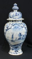 A late 18th century blue and white Delft vase and cover, painted with flowers, sailing boats and