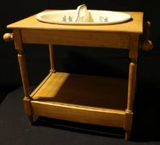 A late 19th/early 20th century child's nursery pine wash stand with ceramic bowl, the bowl blue