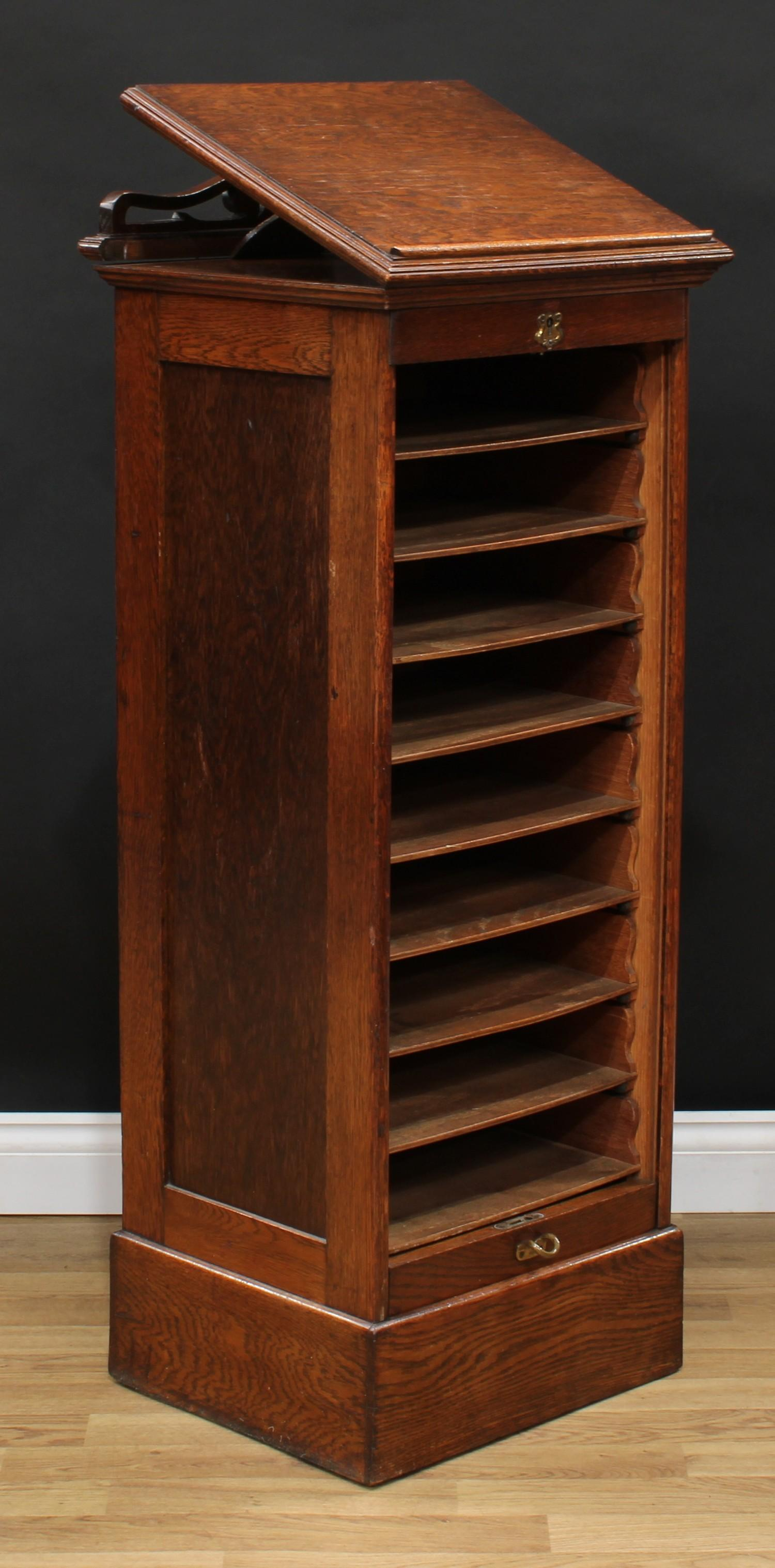 An oak tambour front filing cabinet, in the Globe Wernicke manner, rectangular top with moulded edge - Image 5 of 5