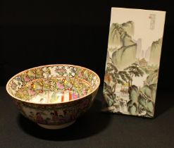 A Chinese famille rose bowl, character marks to base, 25.5cm diameter; a Chinese porcelain panel