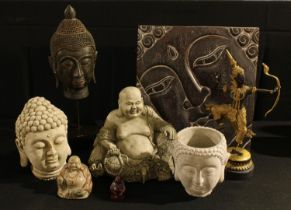 An Indonesian carved wooden bust of The Buddha, 36cm; a Balinese carved wooden panel similar,