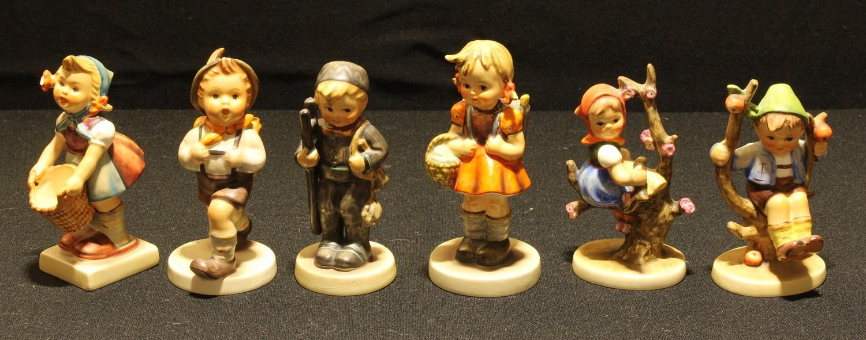 Goebel Hummel figures including Chimney Sweep, Apple Tree Boy, Apple Tree Girl, School Boy, School