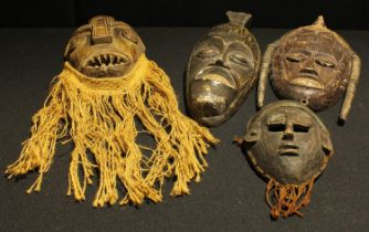 Tribal Art - an African carved wooden wall mask, three others similar (4)