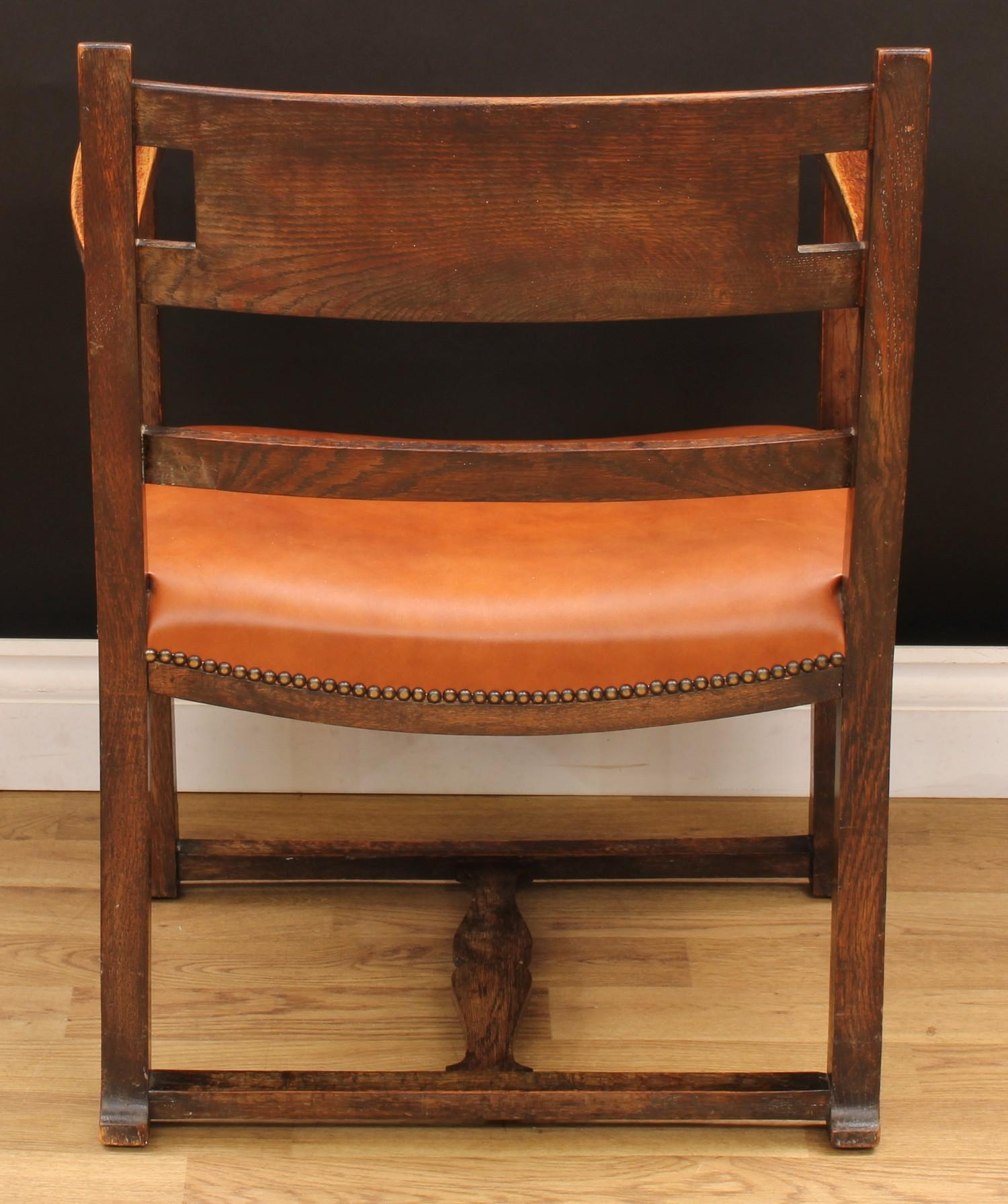 An Arts & Crafts ecclesiastical open armchair, curved cresting rail centred by a shield shaped - Image 4 of 4