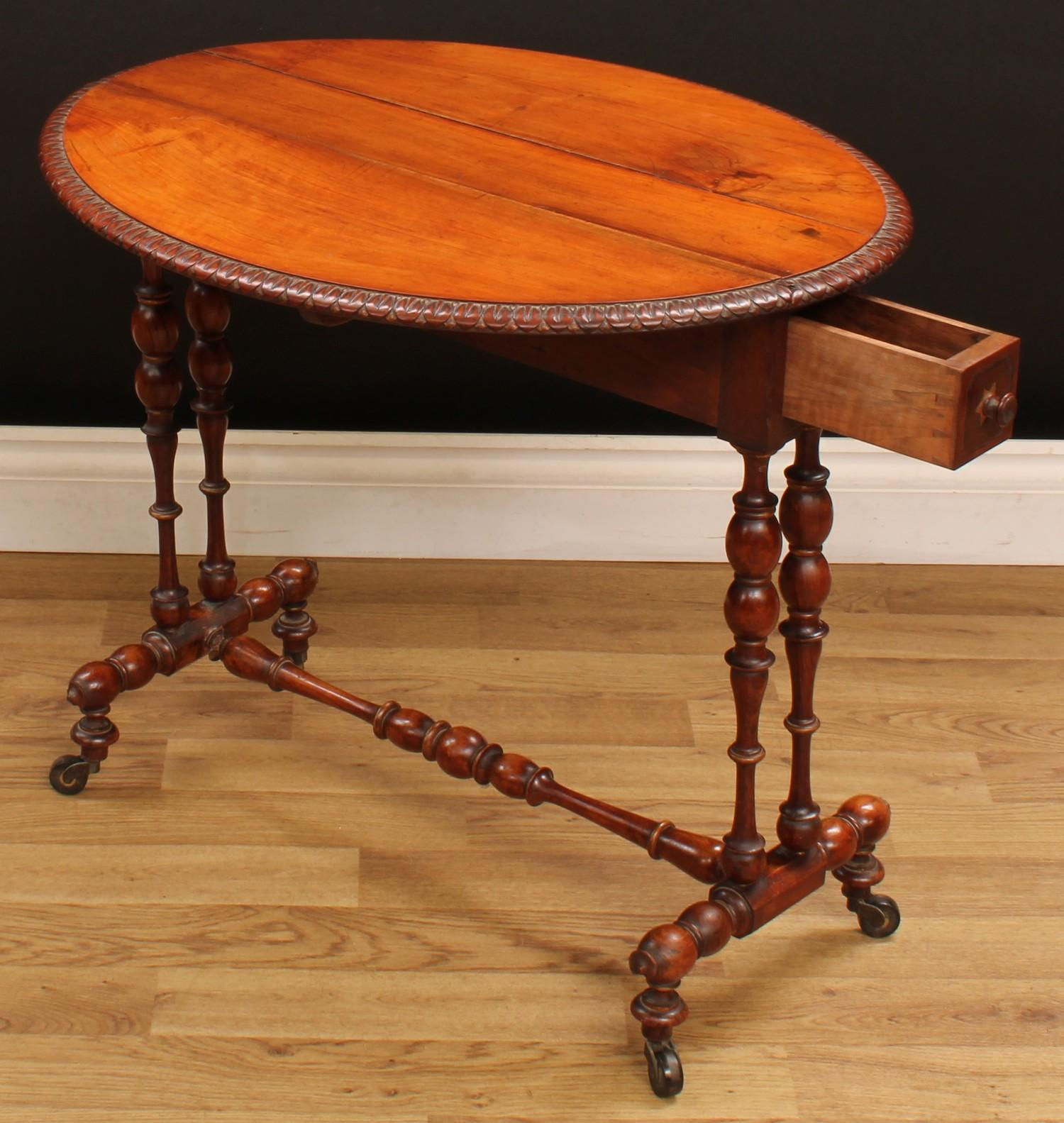 A Victorian walnut Sutherland table, oval top with fall leaves and lotus carved edge, above a pair - Image 2 of 5