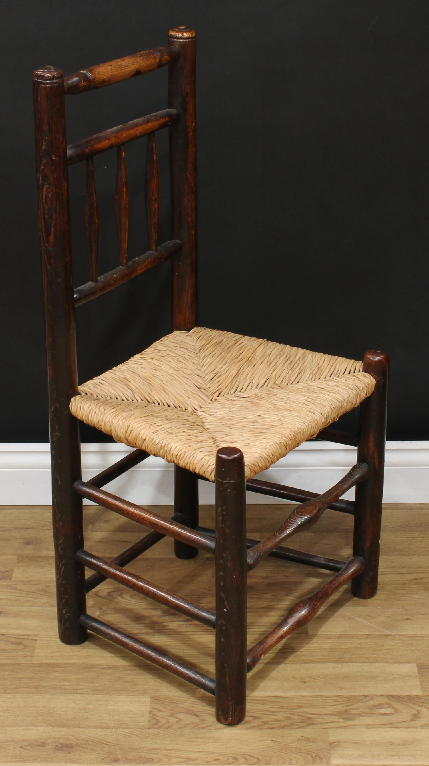 A late Victorian smoker's bow elbow chair, 80cm high, 65cm wide, the seat 38cm wide and 37cm deep; - Image 5 of 7