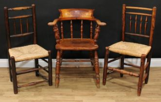 A late Victorian smoker's bow elbow chair, 80cm high, 65cm wide, the seat 38cm wide and 37cm deep;