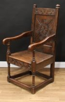 An 18th century oak Wainscot armchair, possibly Cheshire, rectangular cresting rail carved with