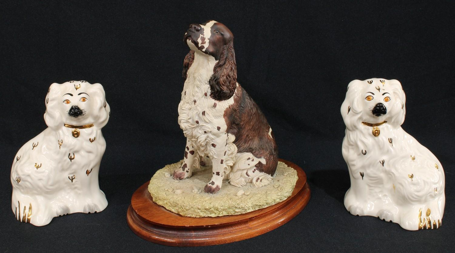 A Border Fine Arts resin model of a spaniel, by Margaret Turner, signed, dated 1993, oval wooden