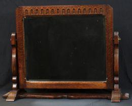 A Frank Pratt/Thomas Jones oak rectangular dressing table mirror, bevelled plate, 56cm high x 77cm