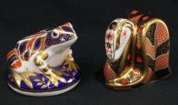 A Royal Crown Derby paperweight, Old Imari Snake, gold stopper; another, Frog, silver stopper (2)