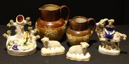 A pair of 19th century Staffordshire sheep; other Staffordshire flatbacks; Royal Doulton salt glazed