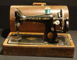 A Singer hand-crank sewing machine, cased