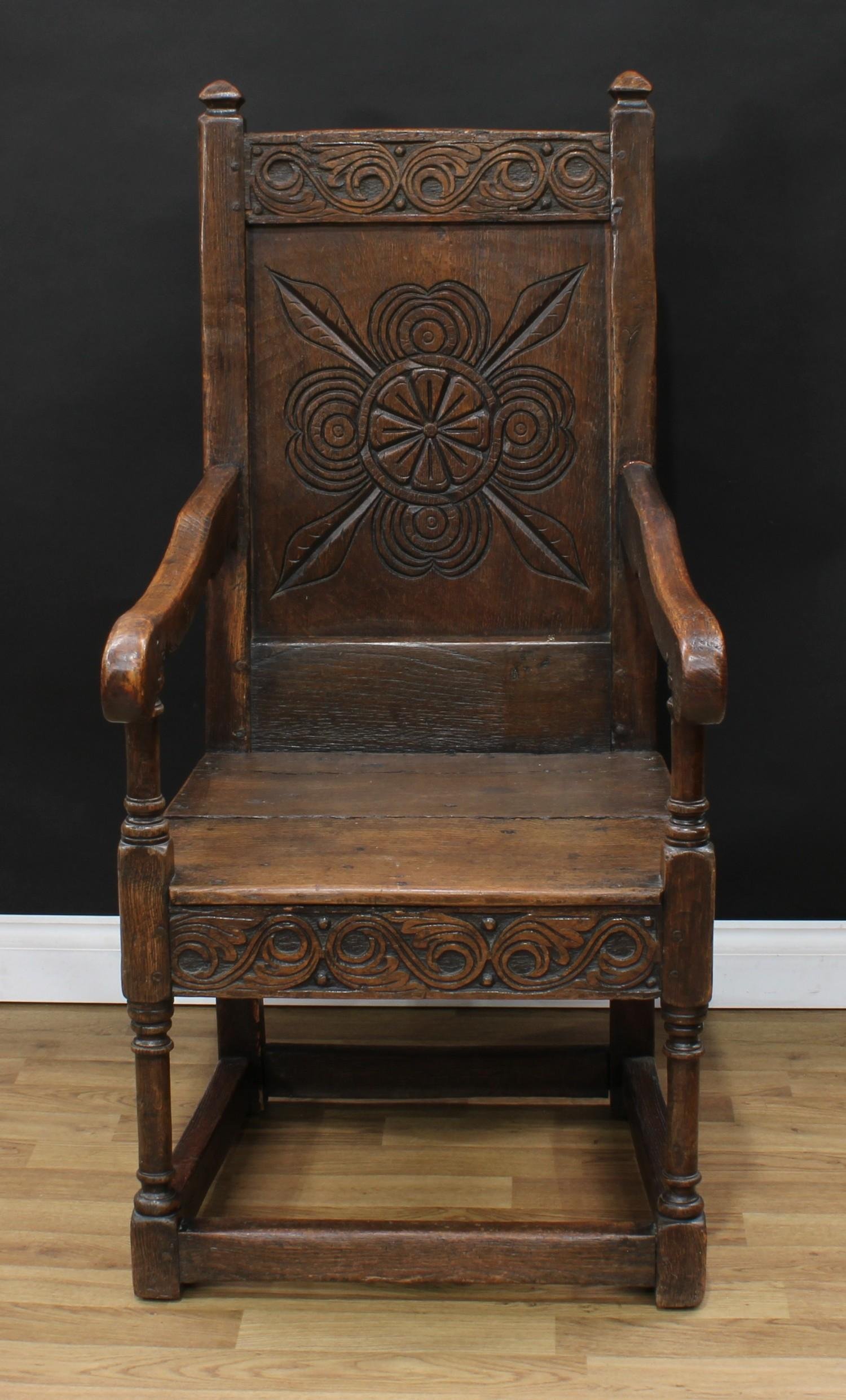 An 18th century oak Wainscot armchair, possibly Cheshire, rectangular cresting rail carved with - Image 2 of 4