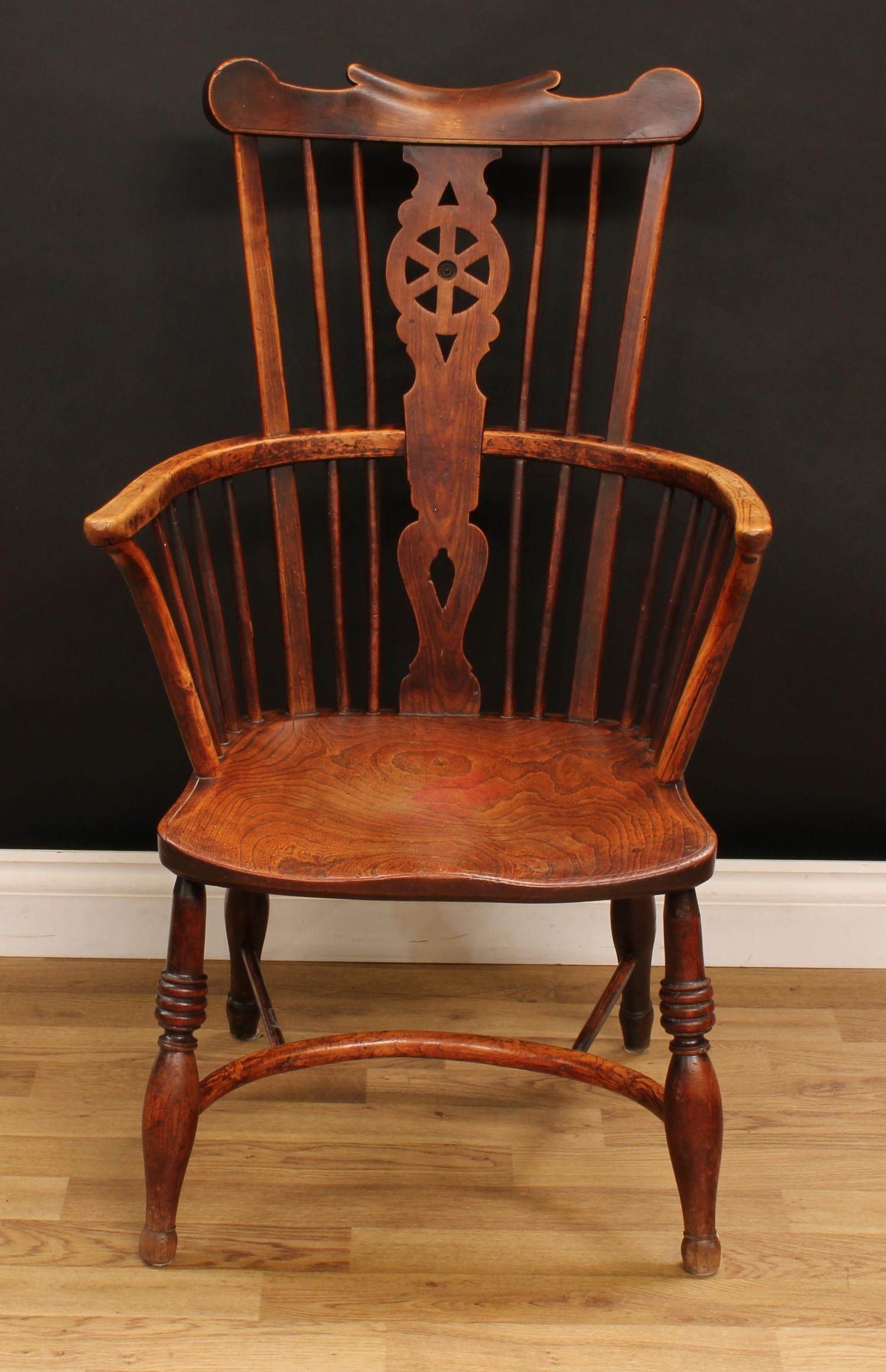 A country house ash and elm Windsor elbow chair, shaped cresting rail above a wheel back splat, - Image 2 of 4