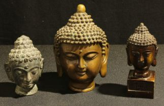 An Indonesian dark patinated bronze bust of The Buddha, 15cm; another as a seal with character